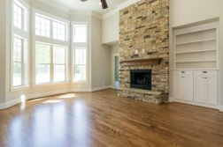 Stone fireplace & custom built-in